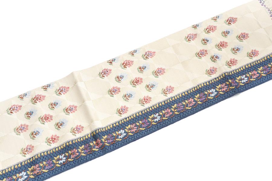 花更紗文の紬地の名古屋帯